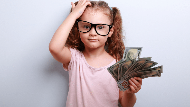 little girl confused about money