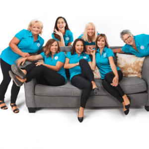 Some of our Doula team laughing on a couch